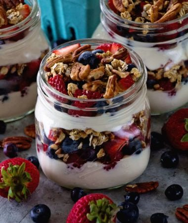 Berry Yogurt Breakfast Parfait ~ Quick, Healthy Breakfast for Mornings When You Are on the Go! Layers of Greek Yogurt, Granola, Strawberries, Blueberries, Raspberries and Pecans!