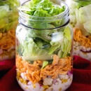 Buffalo Chicken Jar Salad ~ Easy, Light and Healthy Lunch Full of Flavor! Layers of Blue Cheese Dressing, Celery, Blue Cheese Crumbles, Corn, Onions, Buffalo Chicken and Lettuce!