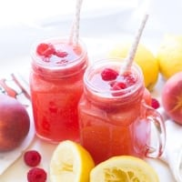 This homemade peach raspberry lemonade recipe is made with only 5-ingredients and takes less than 15 minutes to put together!
