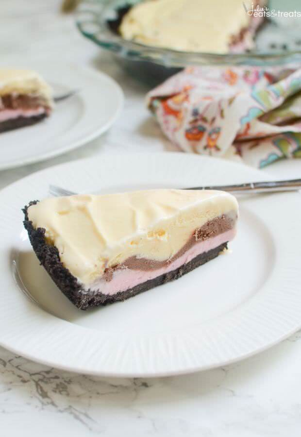 No Bake Neapolitan Ice Cream Pie ~ This Quick and Easy Dessert Starts with a Oreo Crust and is Layered with Strawberry, Chocolate and Vanilla Ice Cream! Only 5 Ingredients to this Dessert!