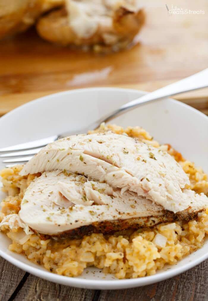 Crock Pot Chicken and Rice on white plate with fork