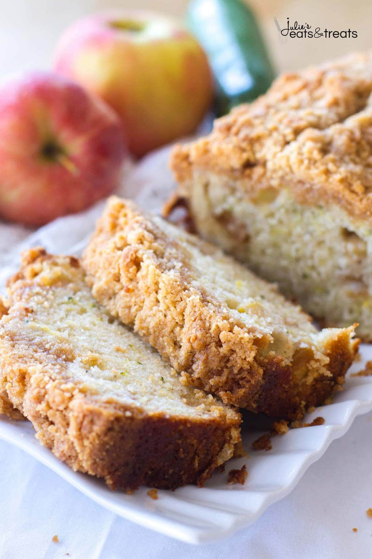Slices of Crumb Apple Zucchini Bread ~ Easy, Quick Bread Recipe Filled with Fresh Grated Zucchini and Sweet Apples then Topped with a Delicious Cinnamon Brown Sugar Crumb Topping!