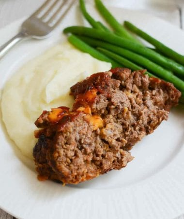 Cheesy Meatloaf ~ Delicious, Homemade Meatloaf just like Grandma Makes! Plus, it has CHEESE! The Ultimate Comfort Food Dinner!