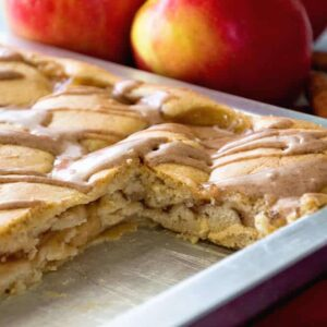 A pan of easy apple pie bars with two bars missing