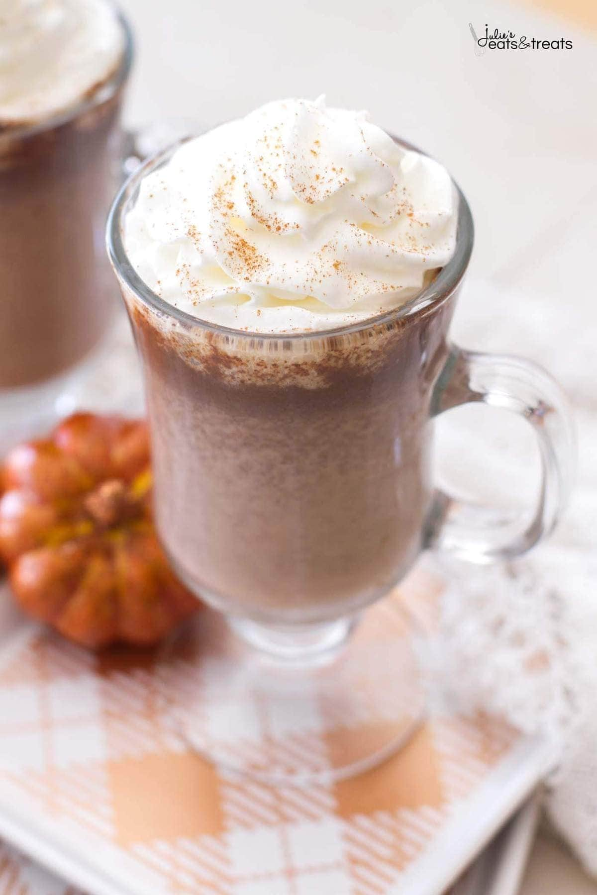 This homemade pumpkin hot chocolate recipe uses real pumpkin puree and pumpkin pie spices to add a fall spin to a classic drink!