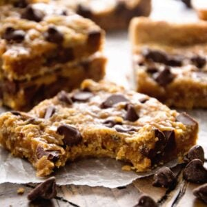 Oatmeal chocolate chip bars on a piece of wax paper