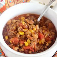 Sausage & Black Eyed Pea Chili - A hearty dinner idea filled with ground beef, black-eyed peas, corn, diced tomatoes, and breakfast sausage! It's quick, easy, and delicious!