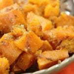 Slow cooker sweet potatoes in a green bowl