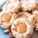 These easy salted caramel almond thumbprint cookies are perfect for any holiday party or cookie exchange! They're sweet, slightly nutty, and incredibly rich with the salted caramel filling!