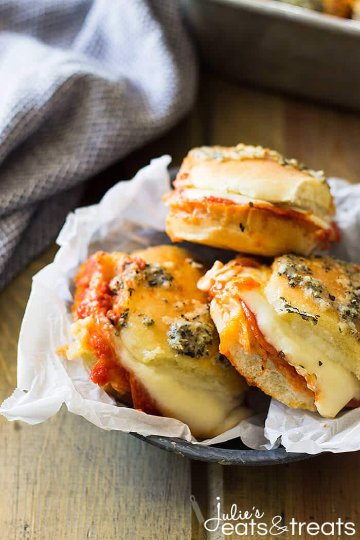 An easy sliders recipe - These Pepperoni Pizza Sliders are quick, easy and perfect for any night of the week! Whether it be game day or just a simple afternoon snack your family will love these!