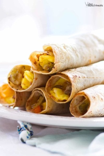 These baked Southwestern Breakfast Taquitos are full of the comforting flavors of scrambled eggs, sausage, potatoes, green chiles, peppers, cheese, and salsa! This easy breakfast recipe is sure to be a new family favorite!