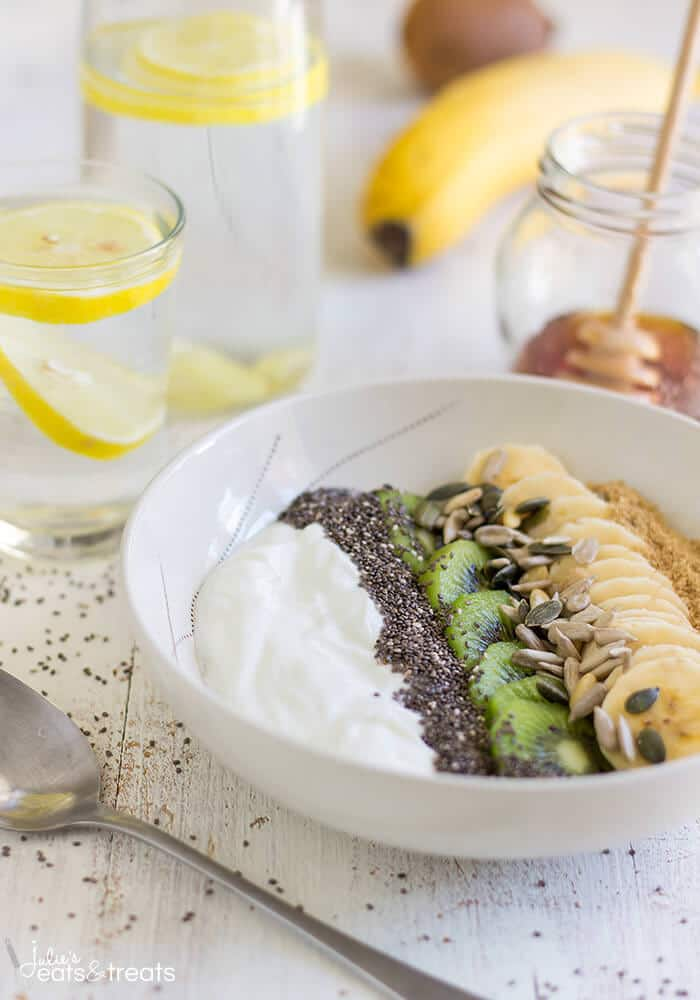 Smoothie Bowl ~ Start off your day with this nutritious meal ready in less than 5 minutes. An easy breakfast with yogurt, fruits and seeds. ~ https://www.julieseatsandtreats.com