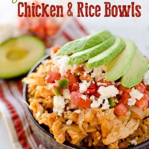 Light crock pot fiesta chicken and rice in a bowl topped with tomatoes and avocado slices