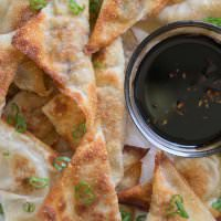 Pork Potstickers ~ Filled with Pork, Cabbage, Mushrooms, Carrots and More! The Perfect Treat When You are Craving Asian Food. Plus, They are Freezable!