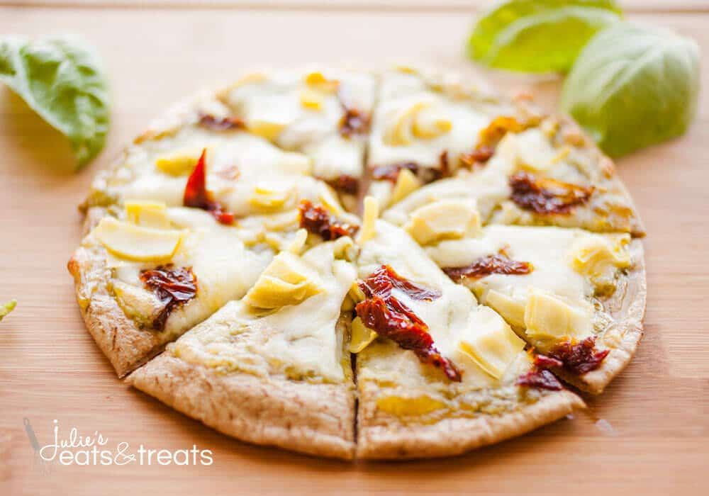 Sun-dried Tomato and Artichoke Pita Pizza. Whip up this personal pizza and have a hot, delicious lunch ready in no time at all! Perfect as an appetizer, too!