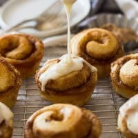 These Cinnamon Roll Muffins are filled with cinnamon and sugar then drizzled with a vanilla icing!