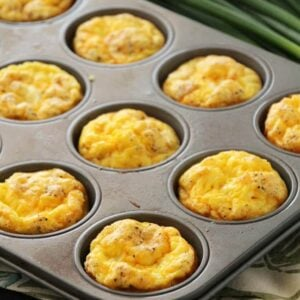 Ham and cheese egg muffins in a muffin tin