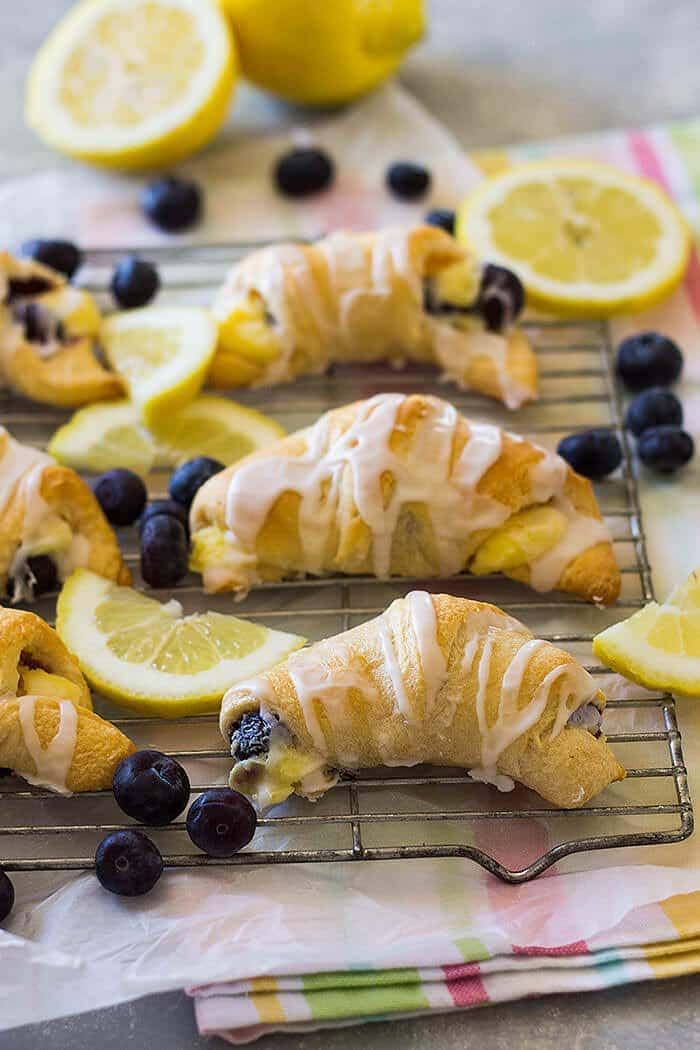 These Lemon Blueberry Cheesecake Crescent Rolls are filled with creamy, sweet and tangy lemon filling and bursting with fresh blueberries!