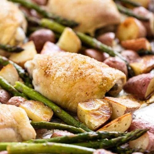 Simple chicken and vegetables on a sheet pan including asparagus and potatoes