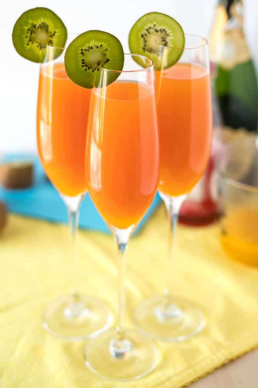Tropical Mimosas - The classic brunch drink, given a tropical twist with the addition of mango, pineapple, and a splash of grenadine.
