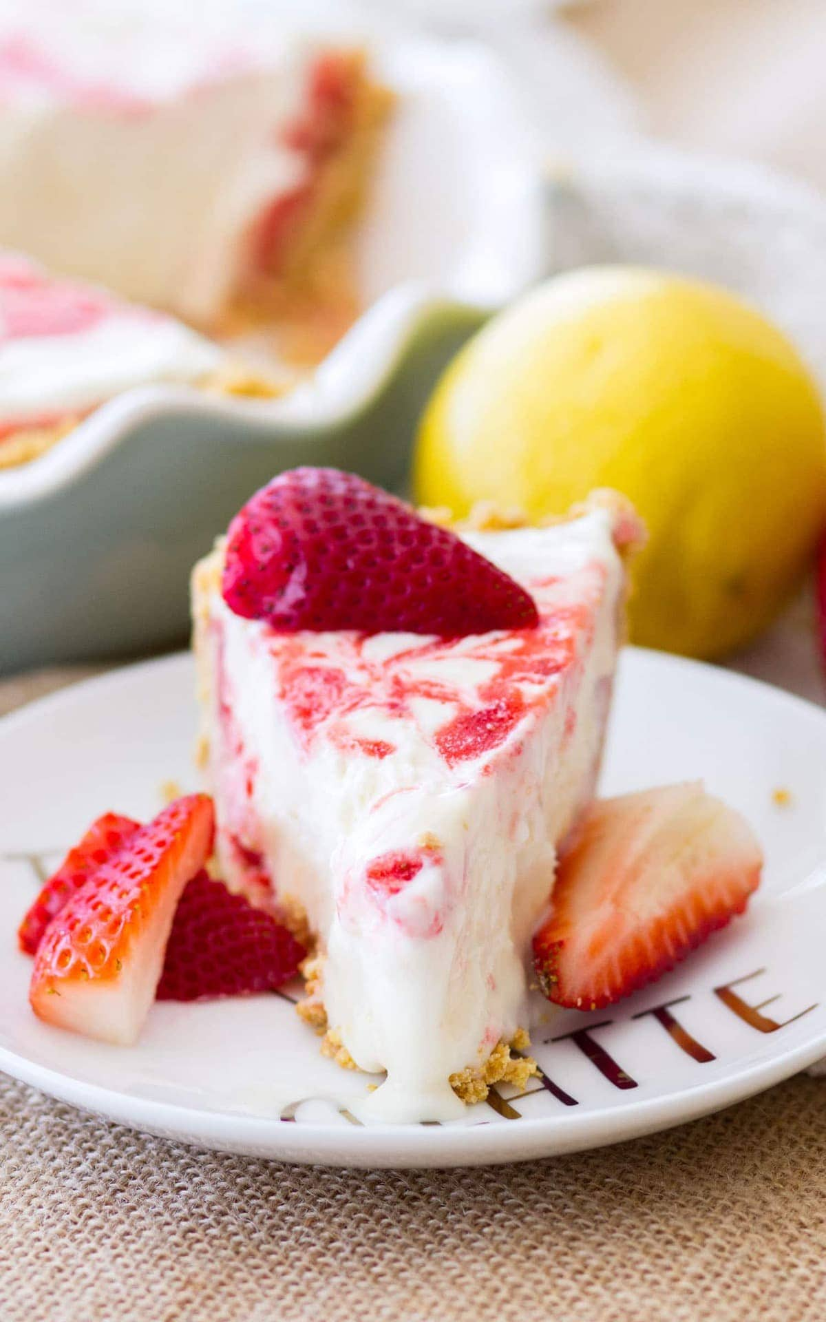 A slice of Strawberry Lemonade Pie. This icebox pie is the perfect no-bake summer dessert!
