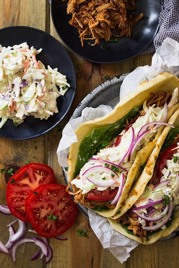 BBQ Pulled Pork Gyros ~ Filled with BBQ Pulled Pork, Creamy Coleslaw, Tomato, Onion and All Wrapped in a Soft Flatbread. Perfect for An Easy Lunch or Dinner!