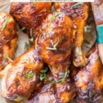 Barbecue baked chicken drumsticks on a plate