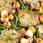 One pan parmesan pork chops and vegetables on a baking sheet