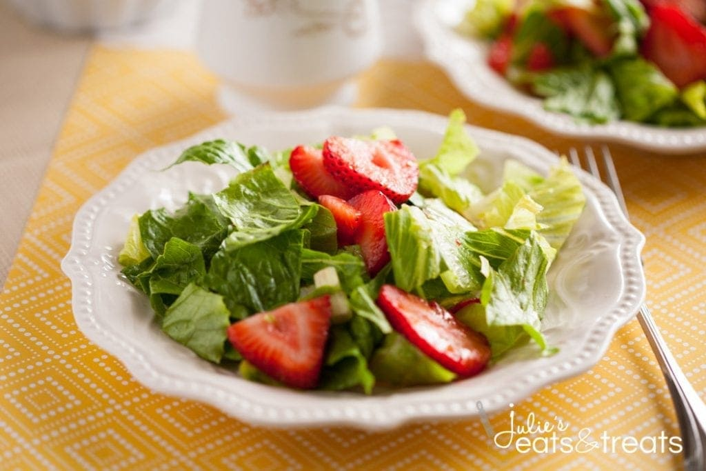 Strawberry Romaine Salad with the most amazing Italian orange dressing! Full of strawberries candied nuts, it is the most delicious salad ever!