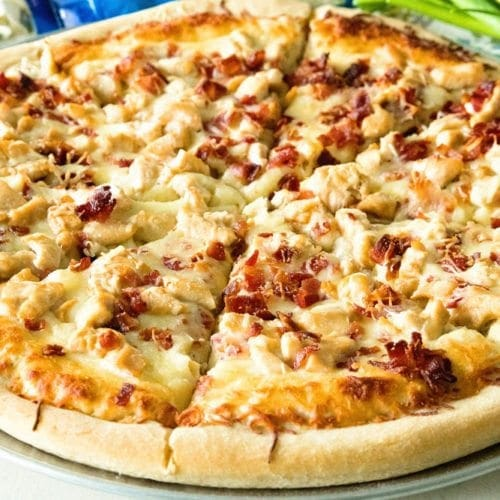 Chicken bacon ranch pizza sliced on a round metal pan