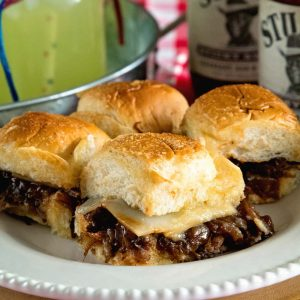 Instant Pot Brisket Sliders with Caramelized Onions ~ Tender, Shredded Brisket Cooked in Your Instant Pot. Stuffed into Sliders Then Topped with Caramelized Onions and Cheese! Perfect Finger Food for Parties!
