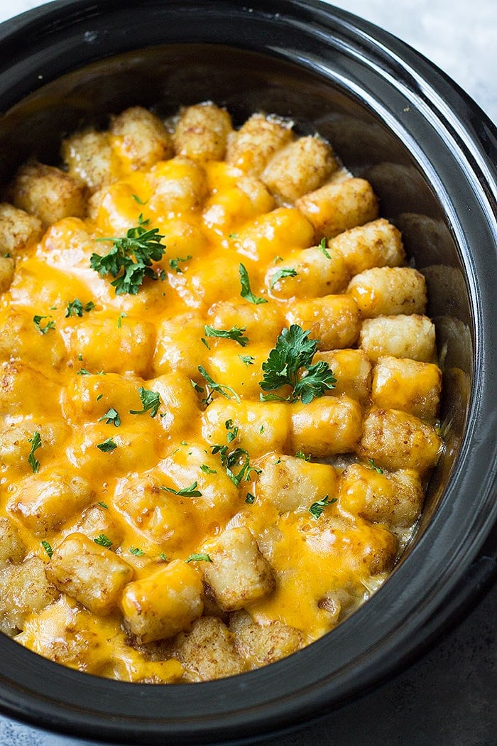 This Slow Cooker Bacon Cheeseburger Tater Tot Casserole is a fun twist on a classic. It's made completely from scratch with no canned soup.
