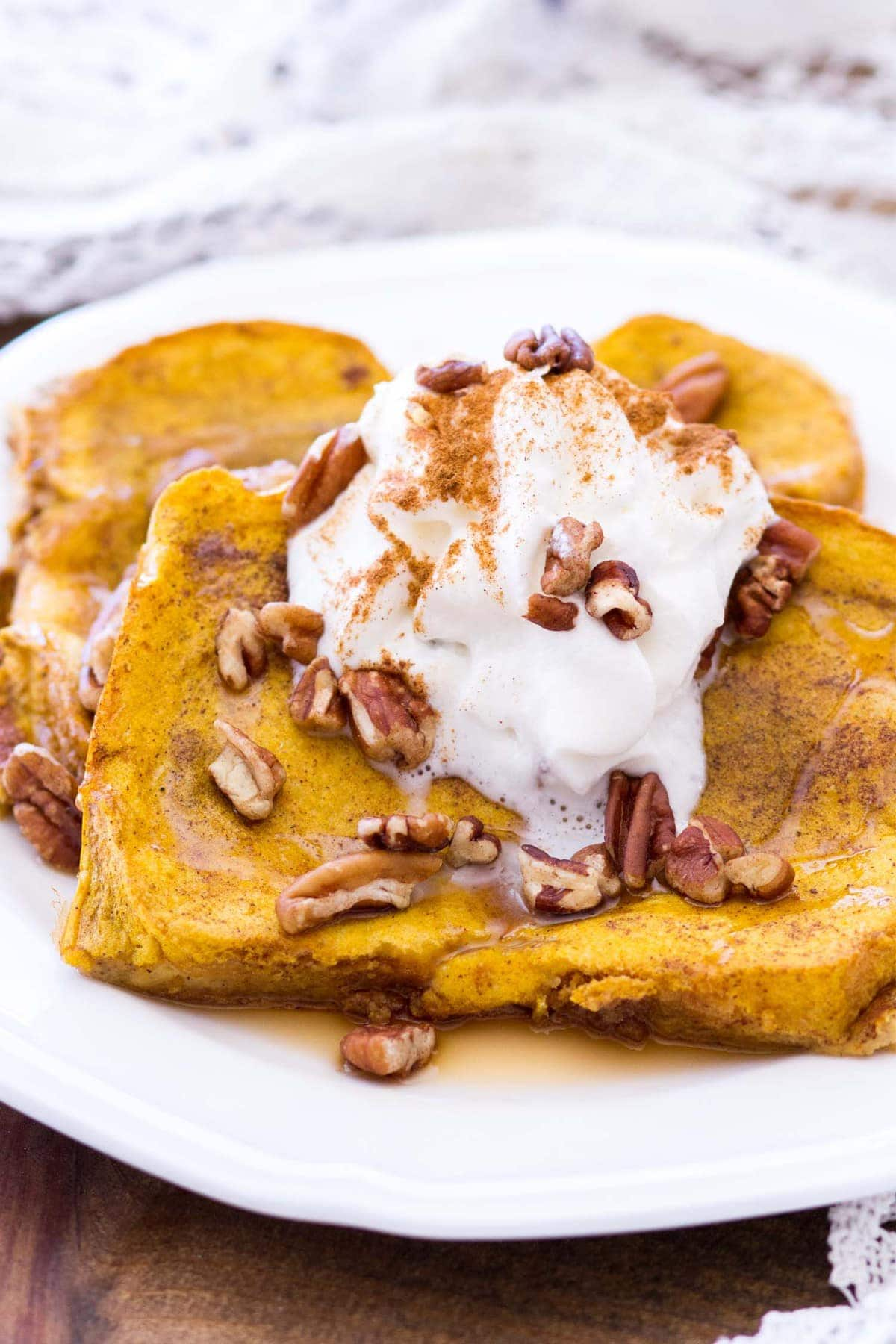 This easy pumpkin french toast recipe is baked in the oven, making this the perfect fall breakfast for any day of the week! Thick-cut bread is soaked in a rich pumpkin custard and baked to perfection!