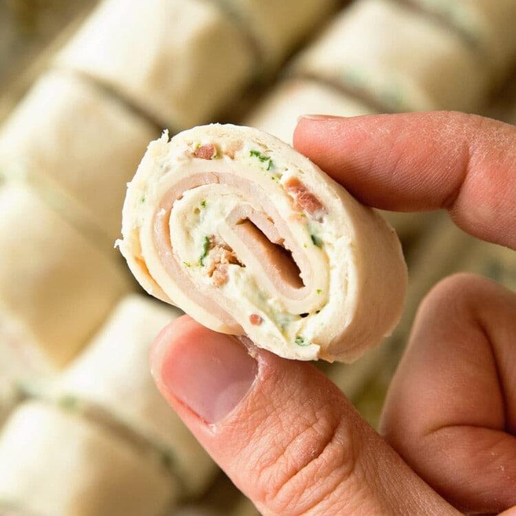 Hand holding a Cheesy Turkey Bacon Ranch Pinwheel