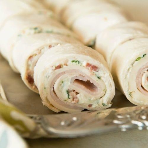 Cheesy turkey bacon ranch pinwheels on a sliver tray