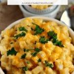 Crockpot cheesy potatoes in a white bowl