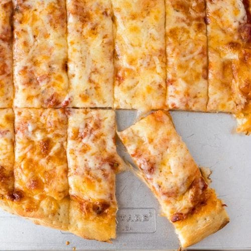 Four cheese pizza dunkers cut on a baking dish