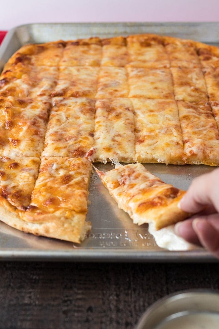 Pizza loaded with four cheese! Perfect for Friday night pizza parties!