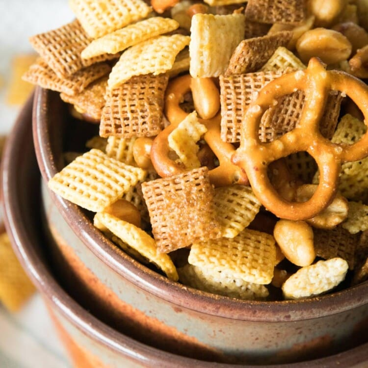 Honey Mustard Snack Mix in a brown bowl stacked in a larger brown bowl
