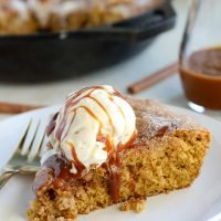 Pumpkin Snickerdoodle Skillet Cookie - Filled with pumpkin, brown sugar and pumpkin pie spice, you'll love the warm and comforting flavors in this easy fall dessert.