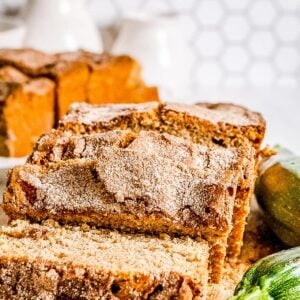 Zucchini Bread that's sliced and starting to lie down on cutting board
