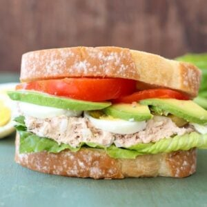 Tuna avocado sandwich with hard boiled eggs, lettuce, and tomato