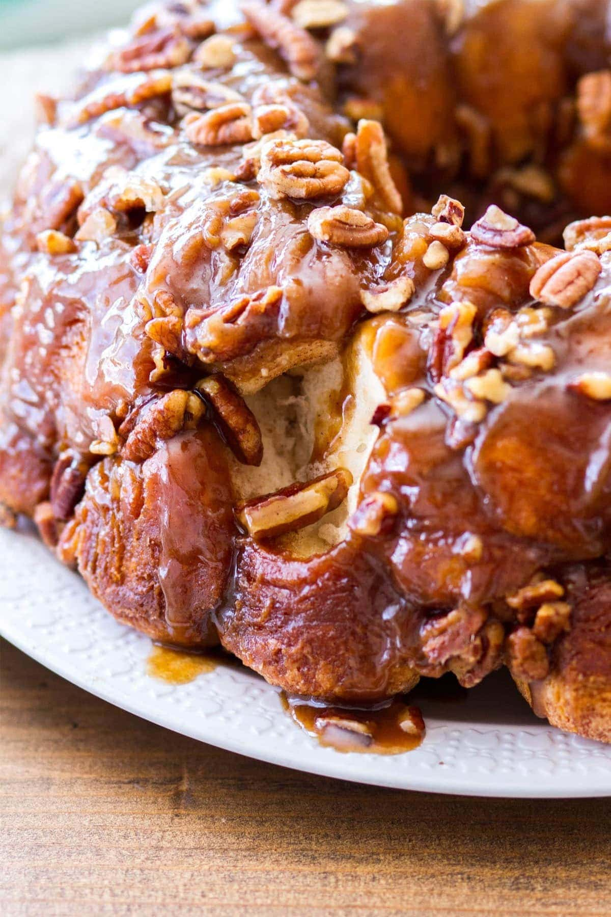 This easy maple pecan monkey bread is perfect for fall! Pre-made biscuit dough is rolled in cinnamon sugar, then baked in a maple pecan caramel sauce that is to die for! This homemade monkey bread recipe makes the best fall breakfast, or even Thanksgiving brunch!