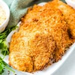 Parmesan Crusted Tilapia Recipe on white platter