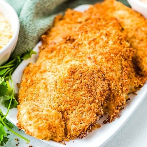 Parmesan Crusted Tilapia on white platter