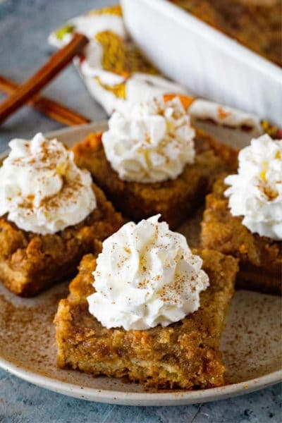 Pumpkin Squares on plate topped with whipped cream