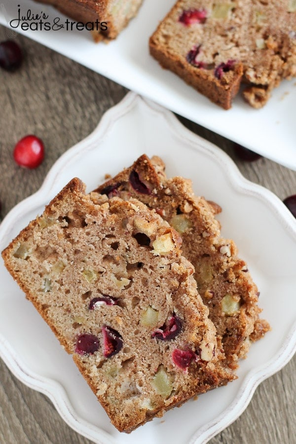 Apple Cranberry Bread - A cinnamon spiced quick bread filled with apples and fresh cranberries and topped with a pecan streusel.