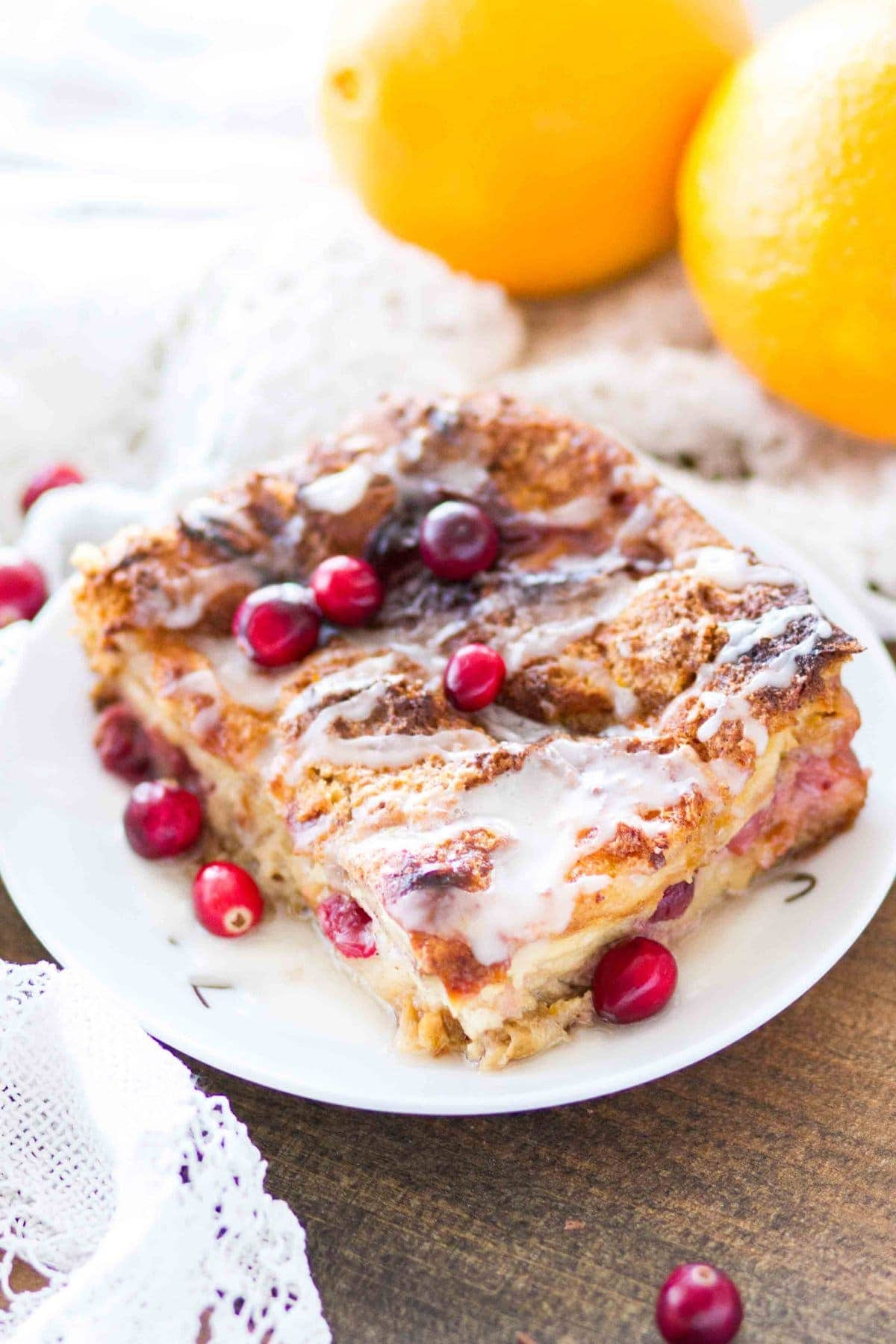 This easy homemade Cranberry Orange Bread Pudding is topped with an orange glaze, and is the perfect holiday dessert! This bread pudding recipe comes together quickly and is a total crowd pleaser!