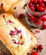 Cream Cheese Cranberry Bread Loaf and a jar of cranberries