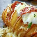 Loaded Hasselback Potatoes ~ Baked potatoes stuffed with cheese and bacon will be a hit at your dinner table. Top them with sour cream and enjoy while warm!